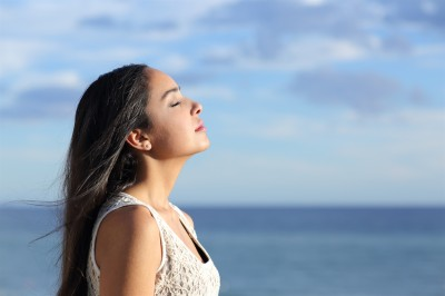 featurepics-Woman-Breathing-Fresh-Air-143858-2823541