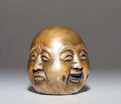 4_faces_buddha
