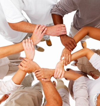Business people holding each others hands in a circle